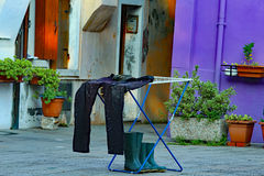 Fisherman's pants and boots dry in a courtyard of the apartment Royalty Free Stock Image