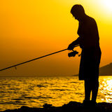 Fisherman S Silhouette On The Beach Royalty Free Stock Photography