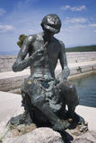 Fisherman's statue in Njivice harbour on island Krk Royalty Free Stock Photo