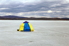 Fisherman's tent. Photo of a fisherman's tent on frozen lake Royalty Free Stock Photo