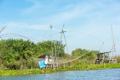 Fisherman`s village in Thailand with a number of fishing tools called `Yok Yor `, Thailand`s traditional fishing tools that made f stock photography