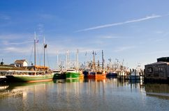 Fisherman's Wharf. Fishing fleet tied up at the dock in the harbor of Cape May, New Jersey royalty free stock photo