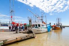 Fisherman's Wharf at Steveston Village in Richmond, BC. RICHMOND, CANADA - JULY 10: Visitors at the picturesque seaside village of Steveston in Richmond near Royalty Free Stock Photo