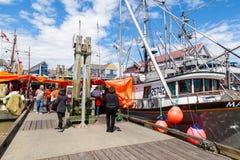 Fisherman's Wharf at Steveston Village in Richmond, BC. RICHMOND, CANADA - JULY 10: Visitors at the picturesque seaside village of Steveston in Richmond near Stock Images