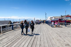 Fisherman's Wharf at Steveston Village in Richmond, BC. RICHMOND, CANADA - JULY 10: Visitors at the picturesque seaside village of Steveston in Richmond near Royalty Free Stock Images