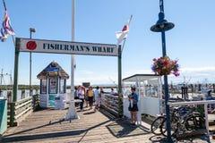 Fisherman's Wharf at Steveston Village in Richmond, BC. RICHMOND, CANADA - JULY 10: Visitors at the picturesque seaside village of Steveston in Richmond near Stock Photos