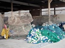 Fishing nets, lobster pots and floats, all get prepred for the day work at sea. A Fisherman`s work doesn`t end at sea; in harbour he must repair and prepare all royalty free stock photo
