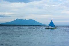Fisherman sailboat at sea. Javanese fisherman sailboat at sea with mountain asa a background Royalty Free Stock Photography