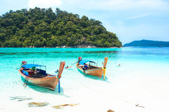 Fisherman sailed longtail boat to visit beautiful beach of Koh Lipe, Thailand Royalty Free Stock Photography