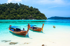 Fisherman sailed longtail boat to visit beautiful beach of Koh Lipe, Thailand Stock Photos