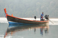 Fisherman sailing boat Stock Image