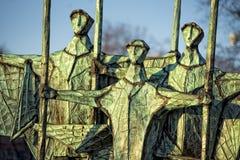 Fisherman sailor silhouette copper statue Stock Photography