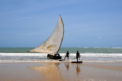 Fisherman sailors. Sail fishing boat ready to leave the beach Royalty Free Stock Photography