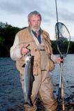 Fisherman with salmon Royalty Free Stock Photo