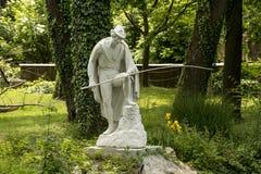 Fisherman. Sculpture of the fisherman in the public garden Maksimir in Croatian capita ZAgreb Stock Image