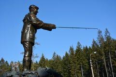 Fisherman sculpture Stock Image