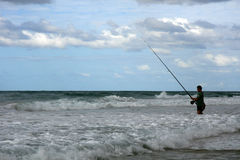 Fisherman in sea stock photo