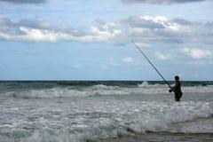 Fisherman in sea Stock Photo