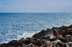 Fisherman in the sea royalty free stock photo