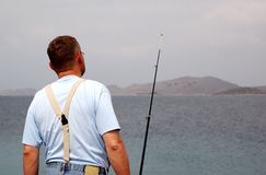 Fisherman at sea fishing royalty free stock photo