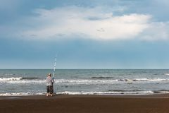Fisherman by the sea stock photos