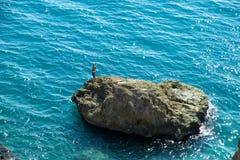 Fisherman at sea stock photo