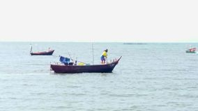 Some time evening sea. Fisherman in the sea Royalty Free Stock Photography