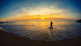 The fisherman on the seashore Stock Images