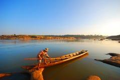 Fisherman set sail in the morning Royalty Free Stock Photos