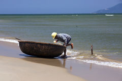 A fisherman in a shell. A fisherman and a shell from Hoi An Royalty Free Stock Photography