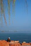 Fisherman on the shore Royalty Free Stock Photo