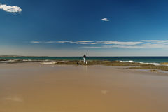 Fisherman on the shore. Fisherman is fishing on the shore Royalty Free Stock Photography