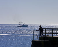 Fisherman and Shrimp Boat Royalty Free Stock Photos