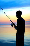 Fisherman silhouette Stock Images