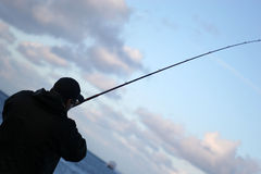 Fisherman Silhouette. Silhouette of a man fishing stock images