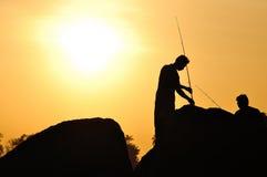 Fisherman silhouette on the beach Royalty Free Stock Photos
