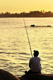 Fisherman silhouette on the beach Stock Photos
