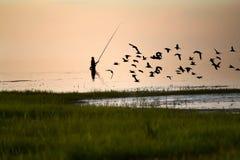 Fisherman silhouette on the lake Stock Image