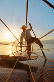 Fisherman silhouette with net at Inle lake Stock Photography