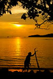 Fisherman silhouette. Silhouette of old fisherman at the beach Royalty Free Stock Photo