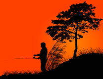 Fisherman silhouette at orange sunset Stock Photos