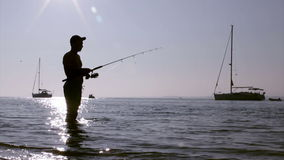 Fisherman silhouette at Ria Formosa wetlands, Algarve, Portugal. stock footage