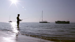 Fisherman silhouette at Ria Formosa wetlands, Algarve, Portugal. Royalty Free Stock Photo