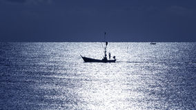 Fisherman silhouette in sea Stock Photo