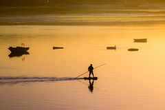 Fisherman silhouette. Sunrise in the harbour of Quellon in Chiloe Island. Patagonia in Chile. Patagonia royalty free stock images