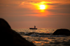 Fisherman silhouette on sunrise, Thailand Royalty Free Stock Photography