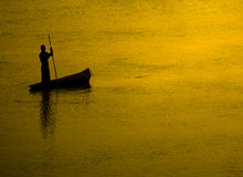Fisherman silhouette at Sunset Royalty Free Stock Photography