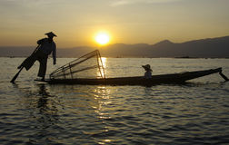 Fisherman Silhouette at Sunset. Royalty Free Stock Image