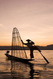 Fisherman silhouette at the sunset on the Inle Lake, Myanmar Stock Images