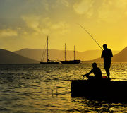 Fisherman silhouette at sunset Royalty Free Stock Images